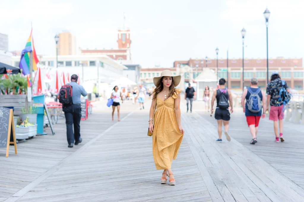 The 5 Summer Dress You Need by top US fashoin blog, House of Leo Blog: image of woman wearing yellow Embroidered Eyelet Maxi Dress, sam edelman Maura wedges and straw floppy hat