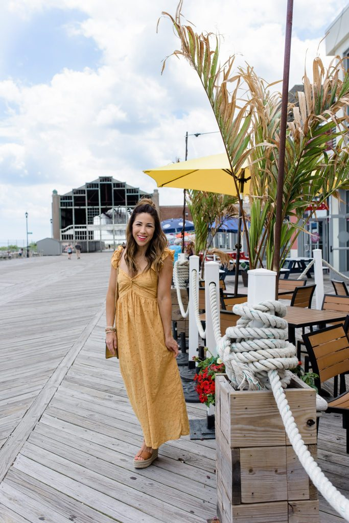 The 5 Summer Dress You Need by top US fashoin blog, House of Leo Blog: image of woman wearing yellow Embroidered Eyelet Maxi Dress, sam edelman Maura wedges