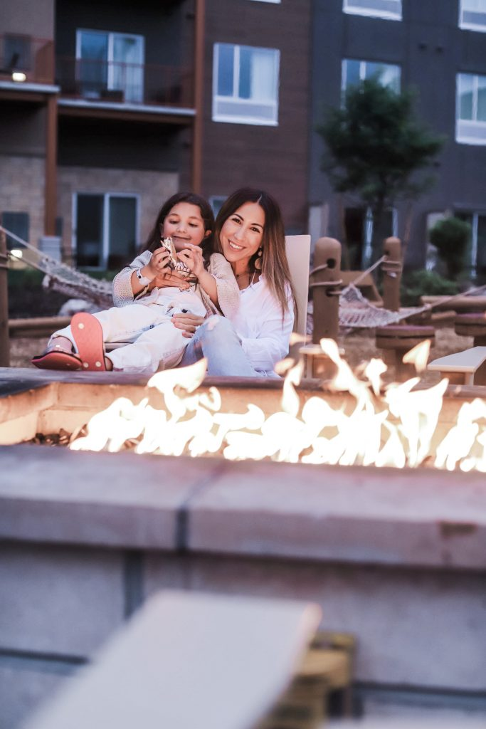 The Kartrite Resort Review by top US lifestyle blog, House of Leo Blog: image of mom and daughter at Kartrite Resort roasting smores