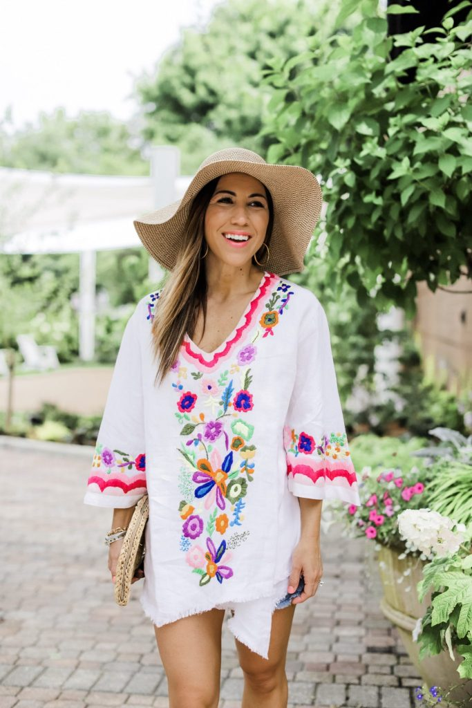 3 Gorgeous Pieces From Paulita Carlotta by top US fashion blog, House of Leo Blog: image of woman wearing embroidered tunic with a straw floppy hat