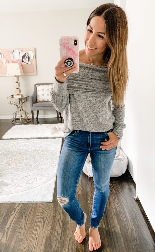 2019 Nordstrom Anniversary Sale Try on and still in stock items by top US fashion blog, House of Leo Blog: image of woman wearing Gibson convertible cozy fleece sweatshirt, STS Blue Ellie jeans