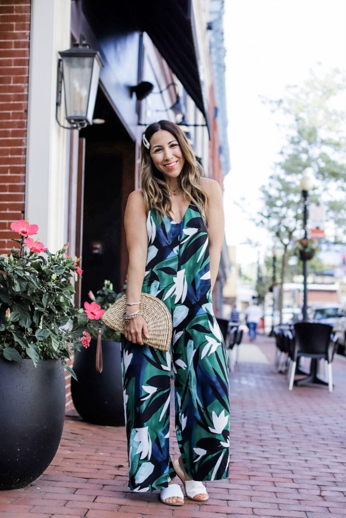 5 Simple Summer Looks from Red Dress Boutique by top US fashion blog, House of Leo Blog: image of woman wearing palm print jumpsuit and straw bag