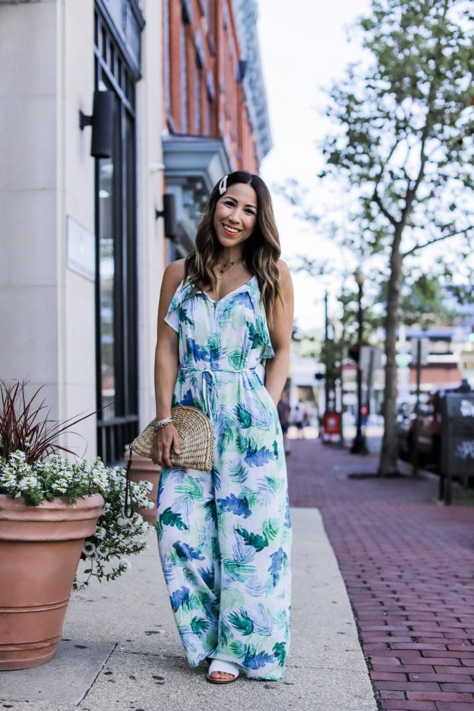 5 Simple Summer Looks from Red Dress Boutique by top US fashion blog, House of Leo Blog: image of woman wearing white palm print jumpsuit