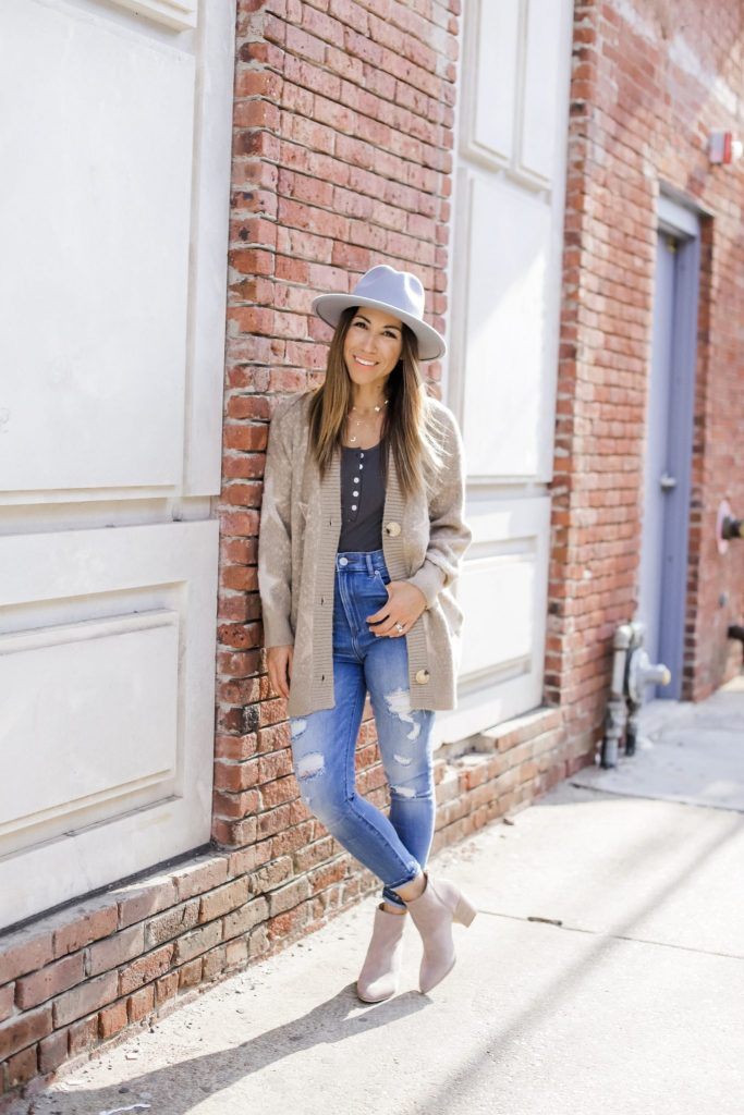 Affordable Fall Pieces to Buy Now by top US fashion blog, House of Leo Blog: image of woman wearing gray wool fedora hat and star cardigan from Goodnight Macaroon