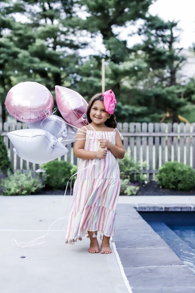 On Your 7th Birthday by top US fashion blog, House of Leo Blog: image of little girl in Chicwish rainbow stripes maxi dress