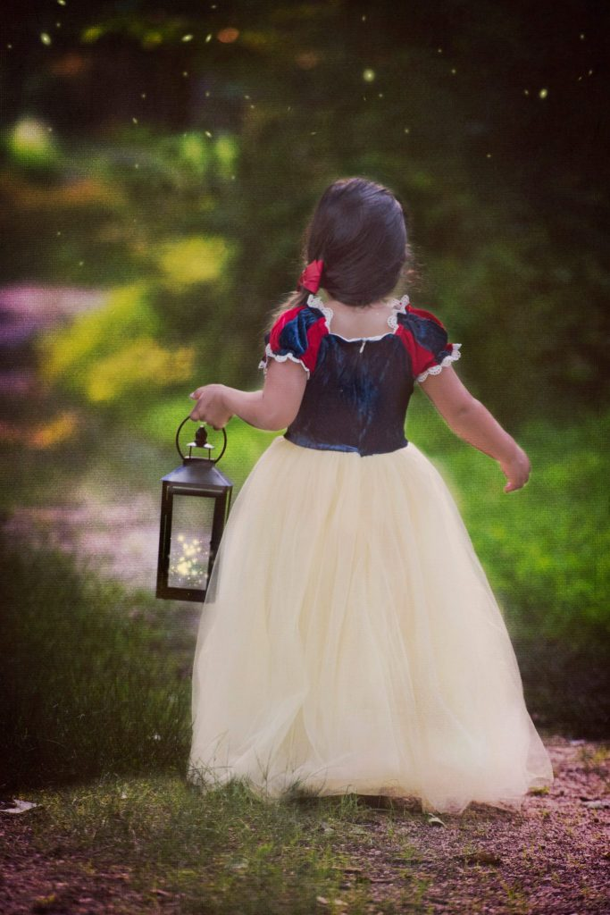 Princess Sessions With April Narby by top US lifestyle blog, House of Leo Blog: image of little girl dressed up as Snow White holding a lantern