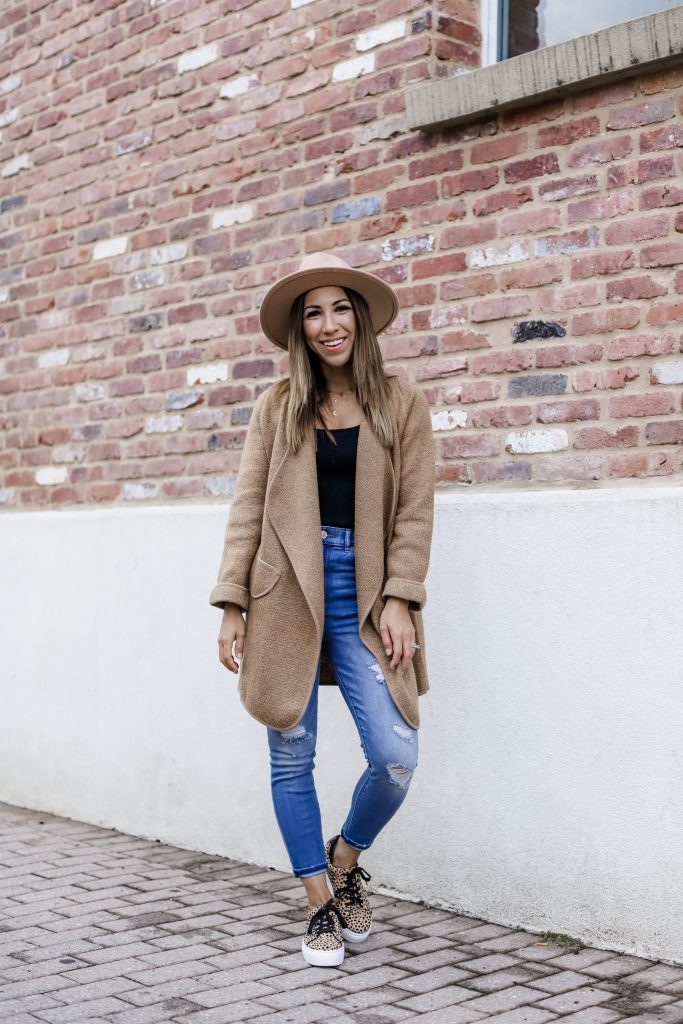 Must Have Fall Cardigan Styled 2 Ways by top US fashion blog, House of Leo Blog: image of woman wearing Goodnight Macaroon open cardigan, Express jeans, leopard sneakers, tan wool fedora hat