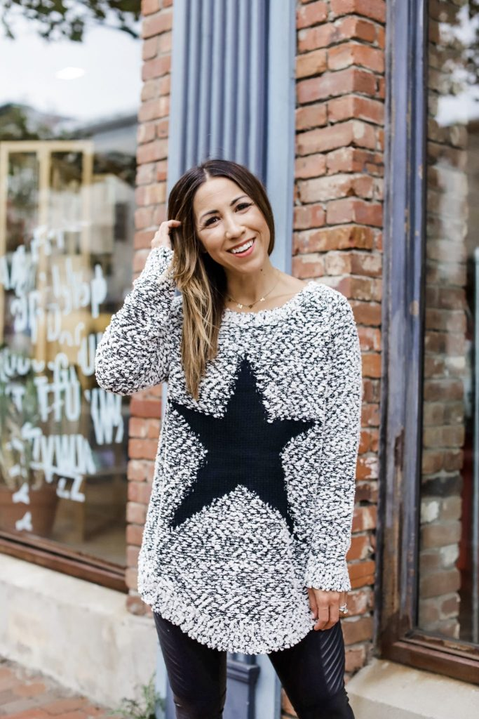 Introducing The Leo Collection by top US fashion blog, House of Leo Blog: image of woman wearing black and white star sweater