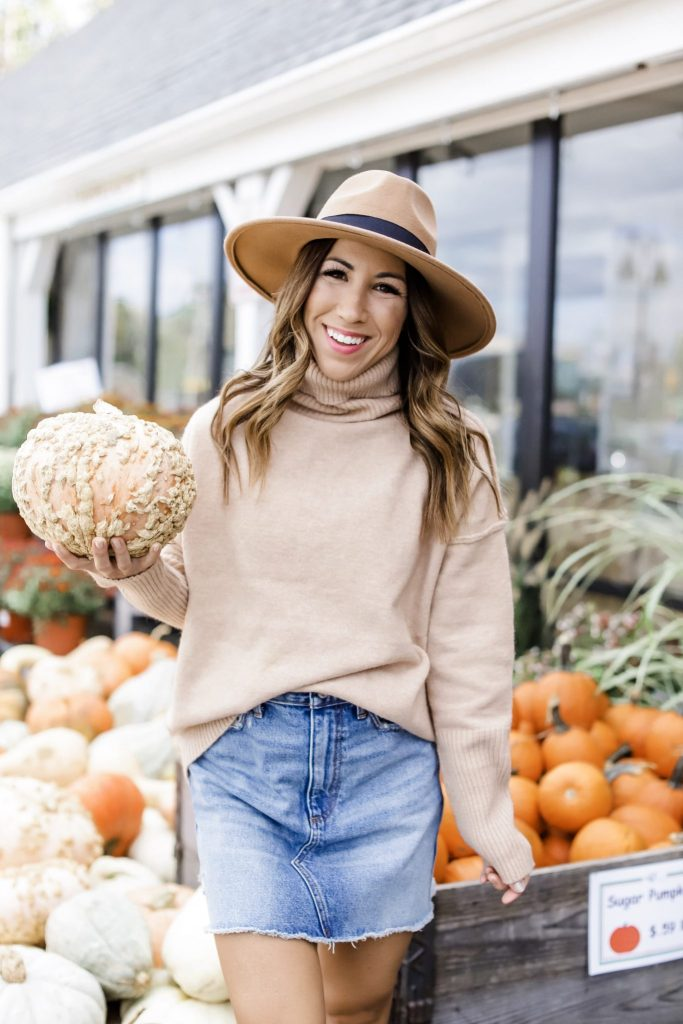 3 Ways To Wear A Denim Skirt This Fall by top US fashion blog, House of Leo Blog: image of woman wearing tan turtleneck, denim skirt and tan wool fedora hat