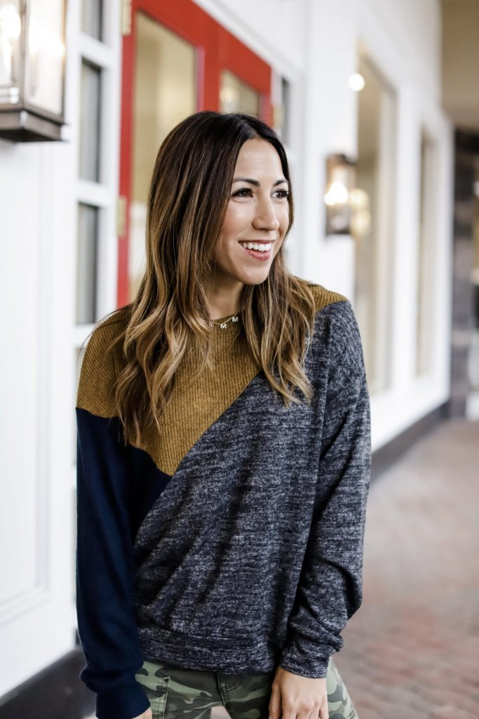 2 Edgy Outfits From Evereve by top US fashion blog, House of Leo Blog: image of woman wearing Peyton Jenson Diagonal pullover