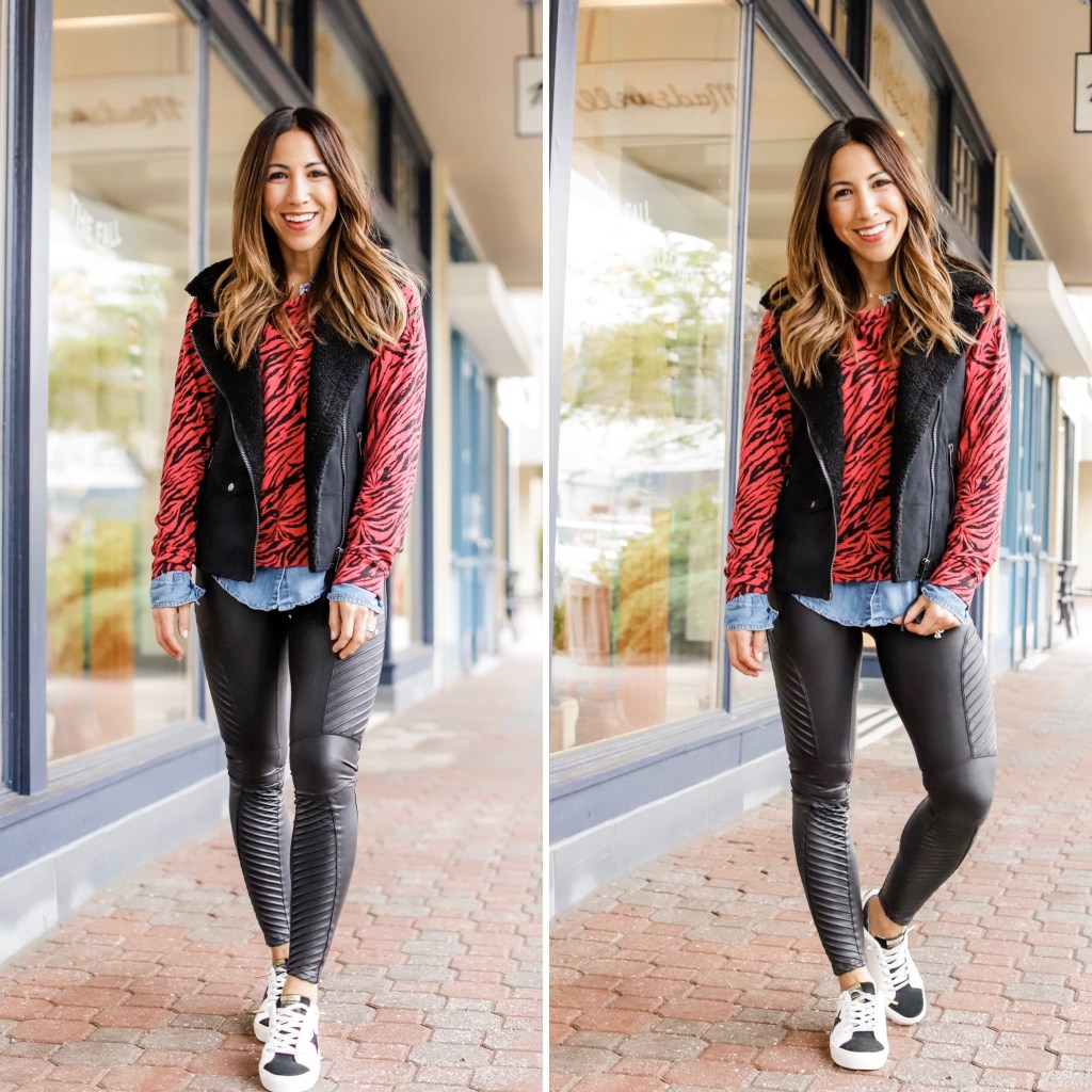 2 Edgy Outfits From Evereve by top US fashion blog, House of Leo Blog: image of woman wearing red zebra sweatshirt, black vest and Spanx moto leggings