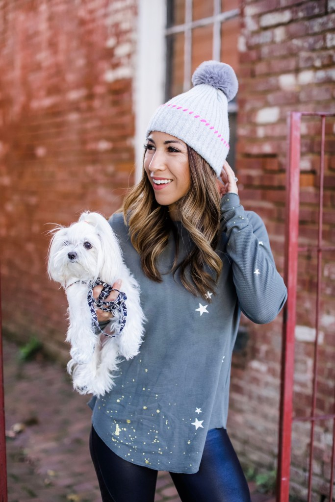 Holiday Outfit Ideas From Evereve by top US fashion blog, House of Leo Blog: image of woman wearing gray star thermal and gray and pink pom pom hat