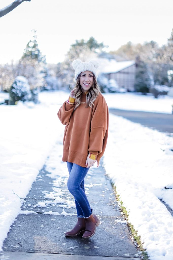 Evereve Winter Clearance Sale by top US fashion blog, House of Leo Blog: image of woman wearing Free People orange sweater