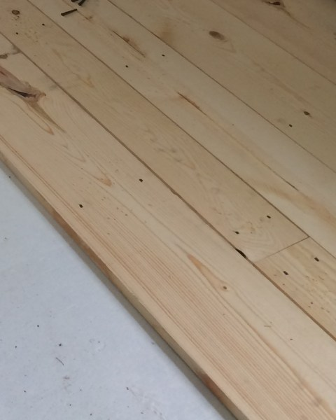 Inexpensive flooring #2 pine boards