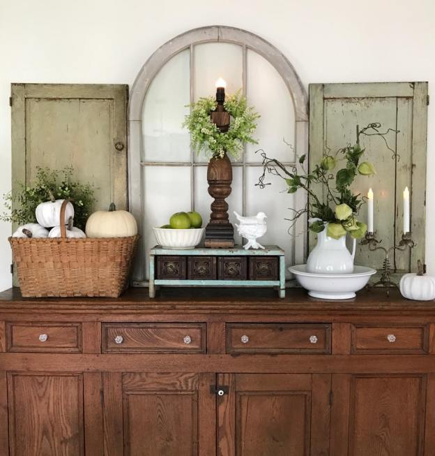 Fall Decor with white pumpkins, greens, and apples, shutters and window - House on Winchester