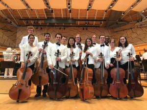 Cellists pose with their instruments and instructor.