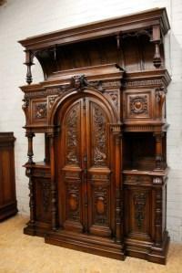 Monumental walnut Henri II castle cabinet