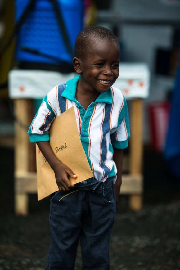 Patrick Poopel holds his certificate that informs the world he is Ebola free in Monrovia in September. Photo: Morgana Wingard / MSF