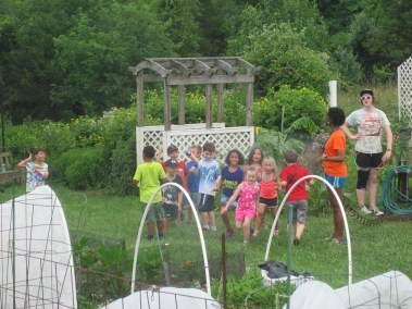 Howard County Conservancy campers water the kids community garden during summer nature camp at Mt. Pleasant