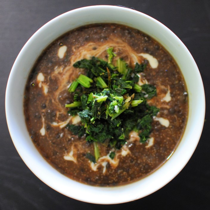 Black lentil and amaranth soup with sesame and roasted kale