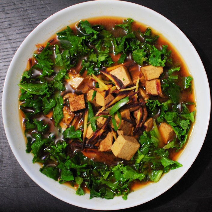 Miso soup with tofu, shiitake mushrooms and kale