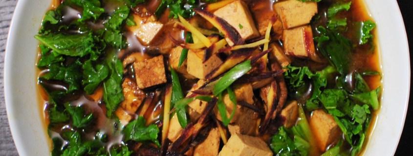 Miso soup with tofu, shiitake mushrooms and kale