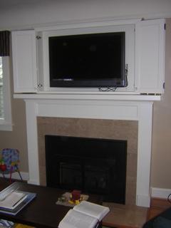Custom dining room sideboard TV cabinet above fireplace mantel