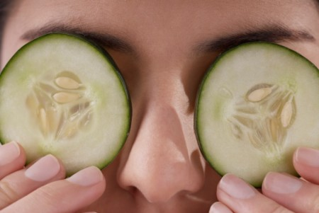 Cucumber slices on red puffy eyes