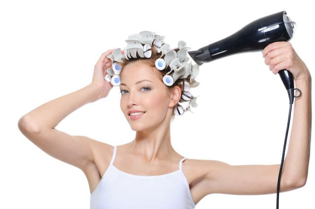 woman drying her head in hair-curlers