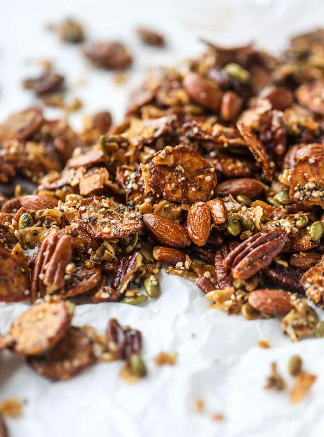 This delicious healthy snack mix is perfect to prep for snacks on the go! It's satisfying, flavorful, both sweet and savory and the best part - is super crunchy. It's full of nuts, some fruit, a bit of coconut, spices, hemp hearts and chia! I howsweeteats.com #healthy #trailmix