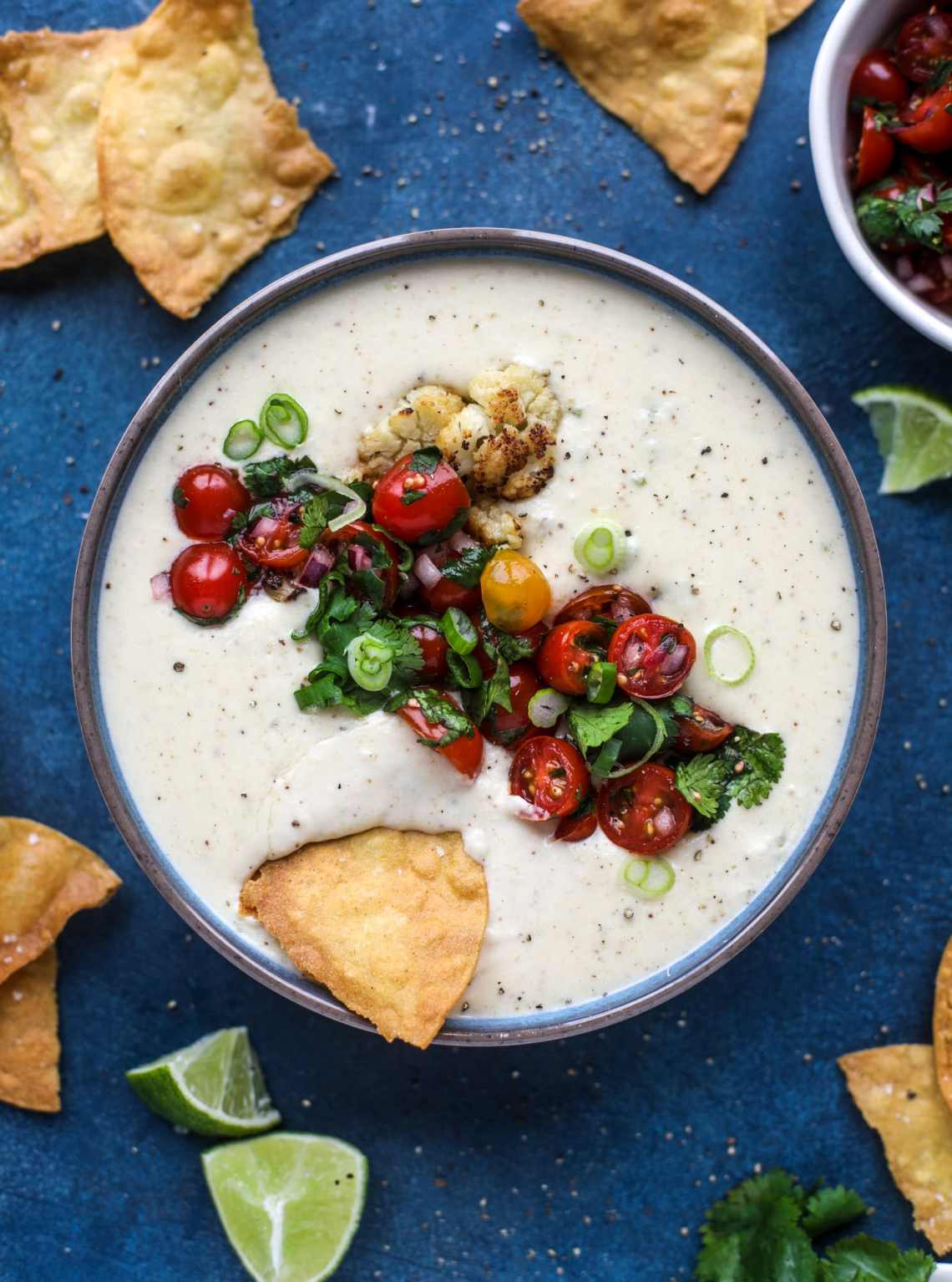 This roasted cauliflower queso has all the deliciousness of regular queso, with roasted cauliflower added in. It's satisfying and tastes like heaven. I howsweeteats.com #cauliflower #queso