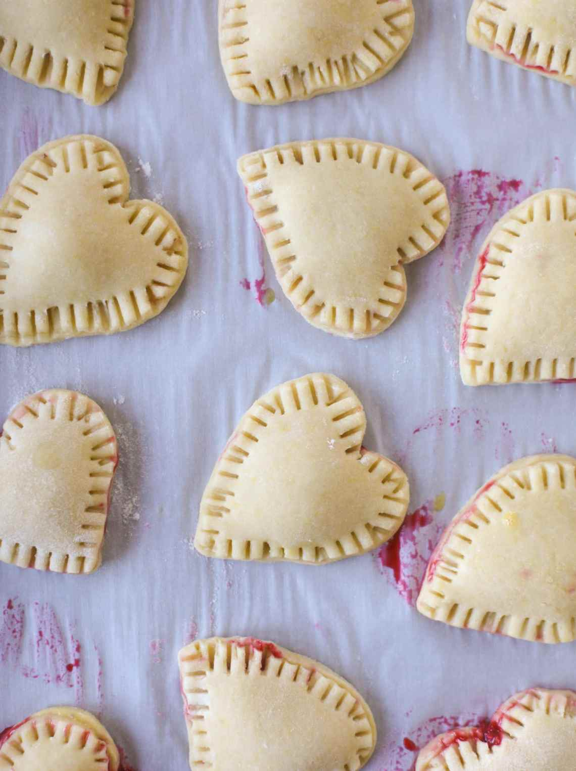 These adorable mini heart pies are filled with a homemade raspberry compote and creamy, chocolatey nutella. So fun and easy to make! I howsweeteats.com #heart #pie
