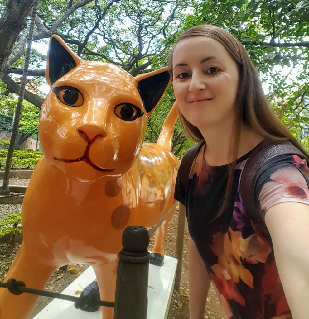 Selfie with cat sculpture at Parque del Gato in Cali, Colombia