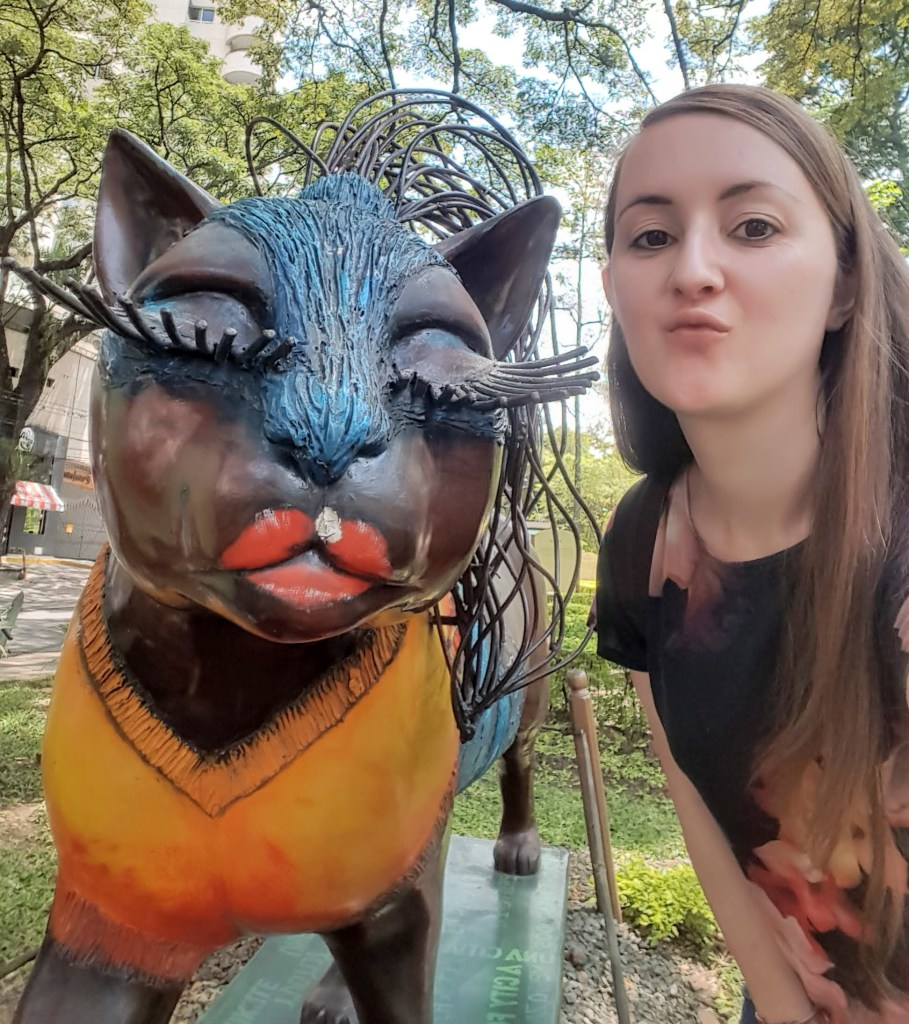 Selfie with cat sculpture in the Parque del Gato in Cali, Colombia.