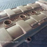 Remove paint on a Integra valve cover.