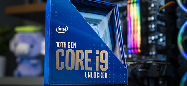 An Intel 10th generation blue processor packaging, with a desktop PC in the background
