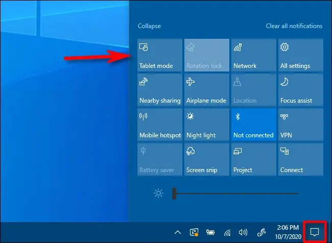 In the Windows 10 Action Center, tap the Tablet Mode button.