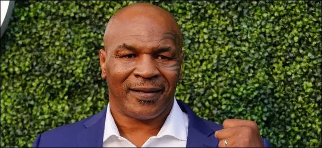 Mike Tyson with a fist raised