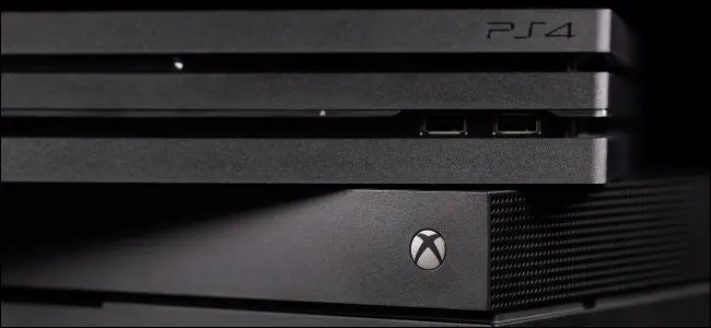 A PlayStation 4 console on top of an Xbox One.
