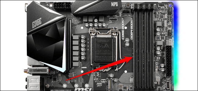 The RAM slots on a motherboard with the red arrow pointing to it.