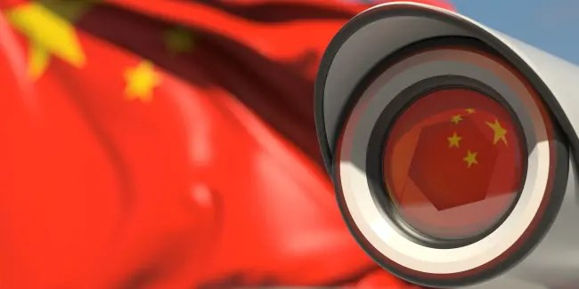 The Chinese flag reflected in a surveillance camera.
