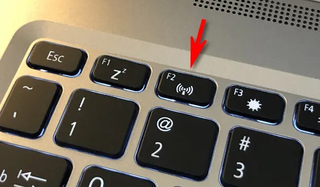 Press the airplane mode or wireless on or off button on your computer.
