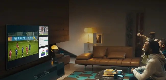People watching sports on QN900A TV