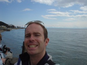 Me (with suitably dopey grin) at Lake Baikal
