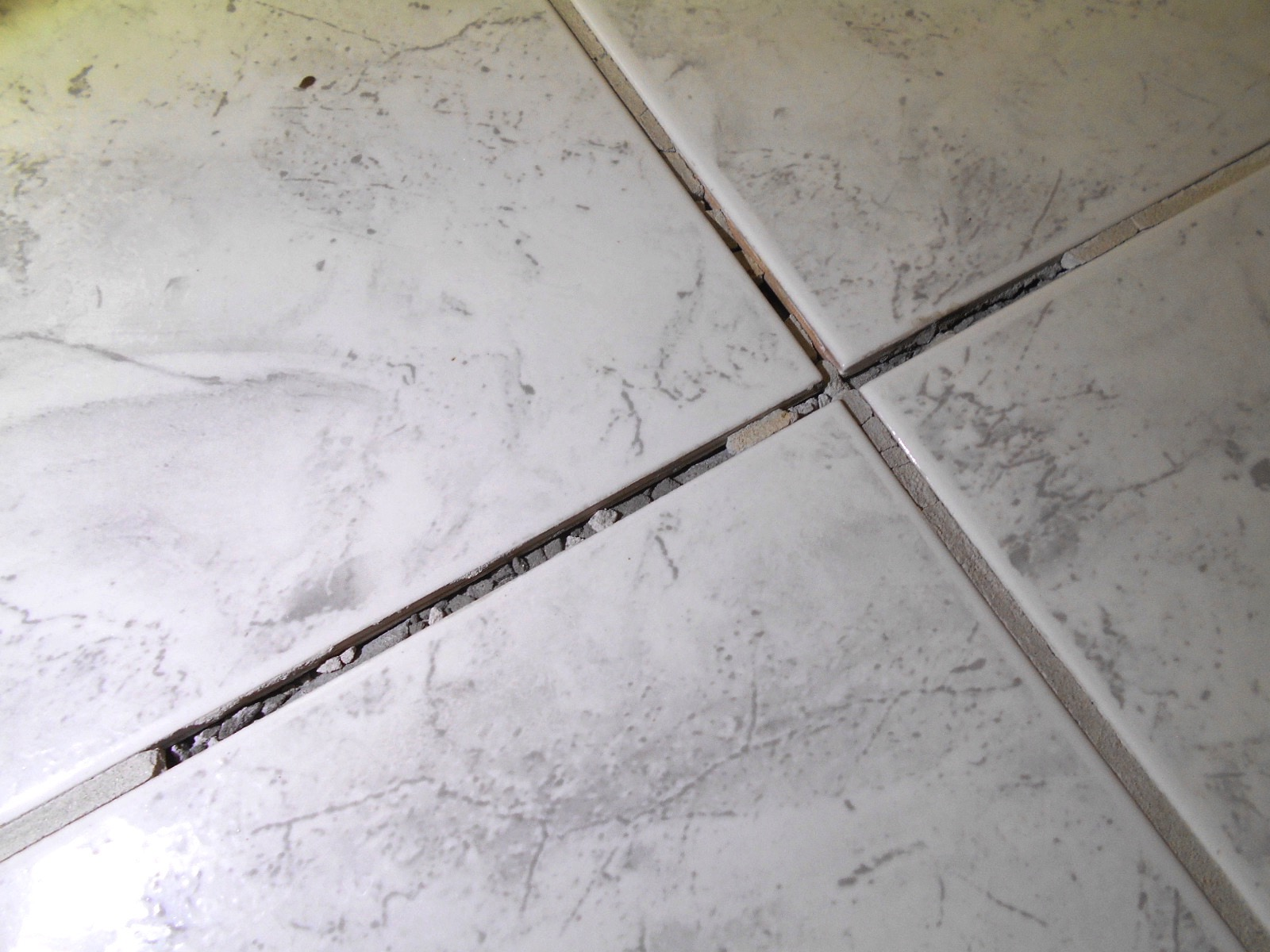 coming loose at my floor tile