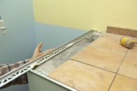 Installing tile edging   HowToSpecialist - How to Build ...