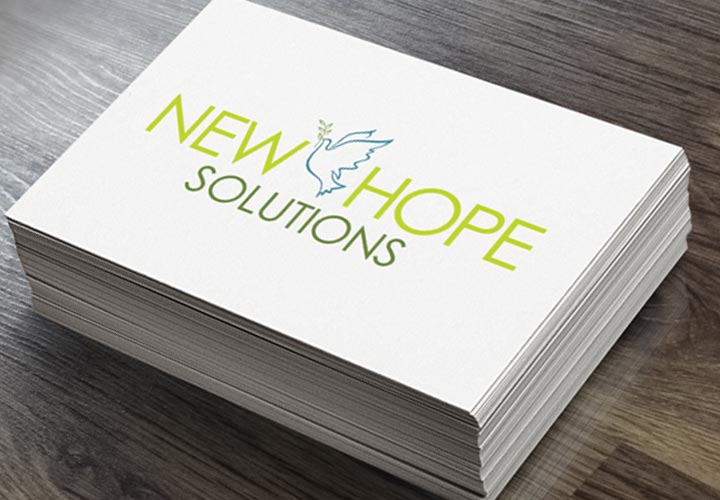 New Hope Solutions business card branding