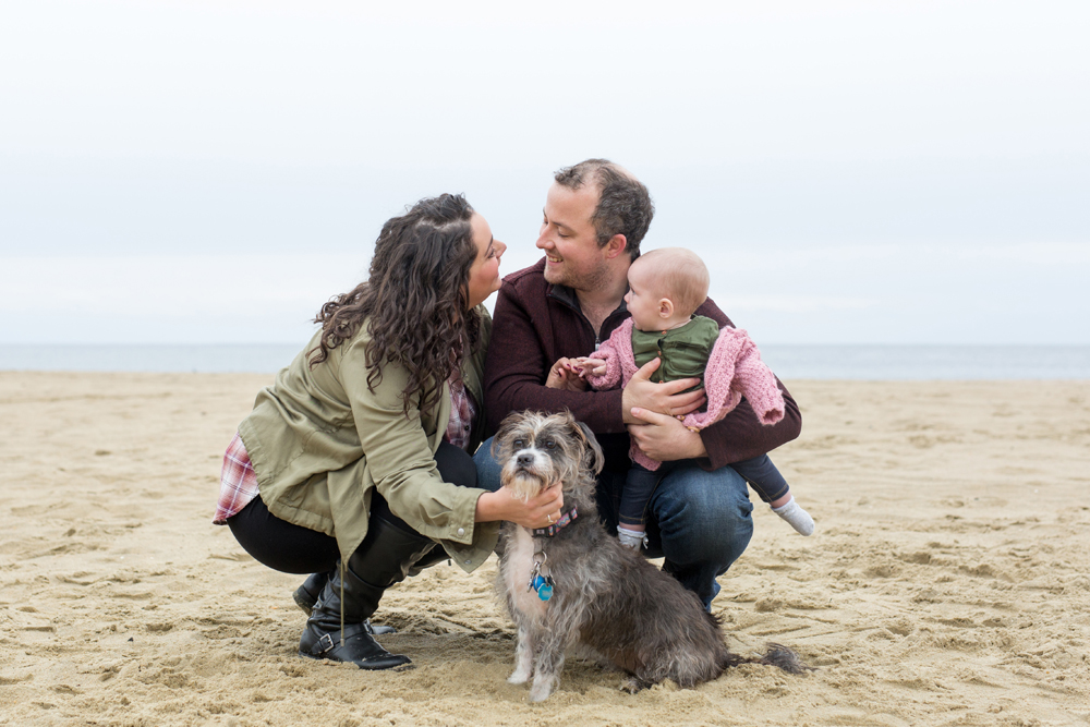 family portrait with dog on beach