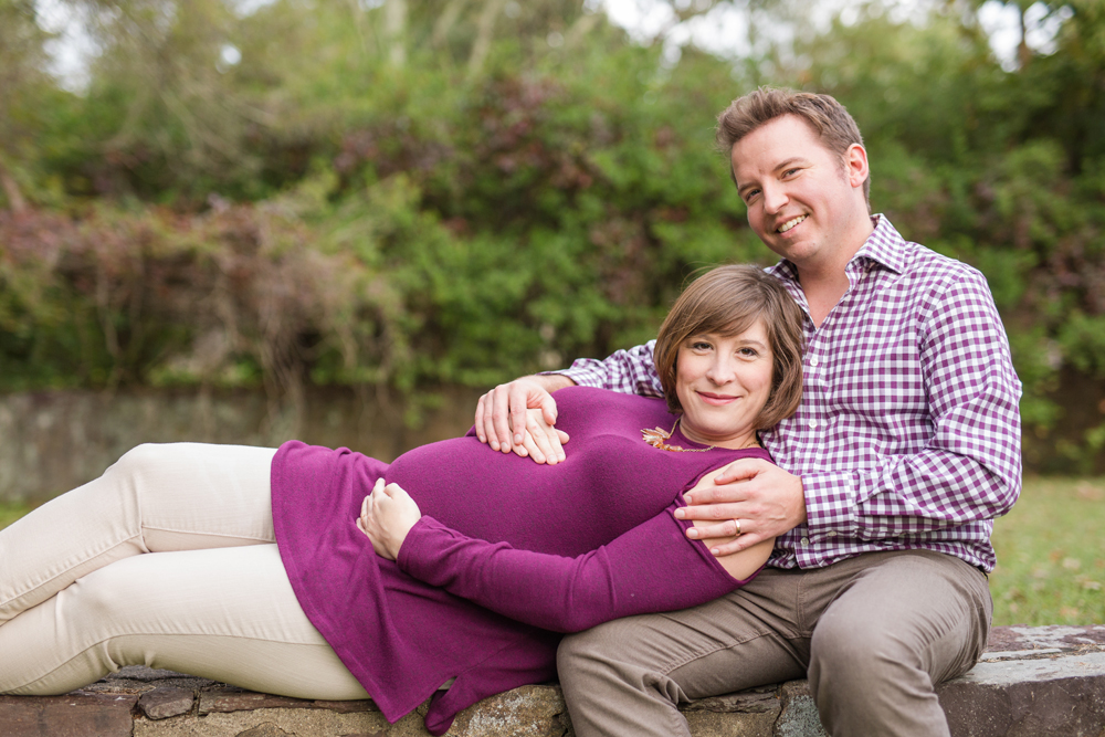 maternity session couple wearing purple