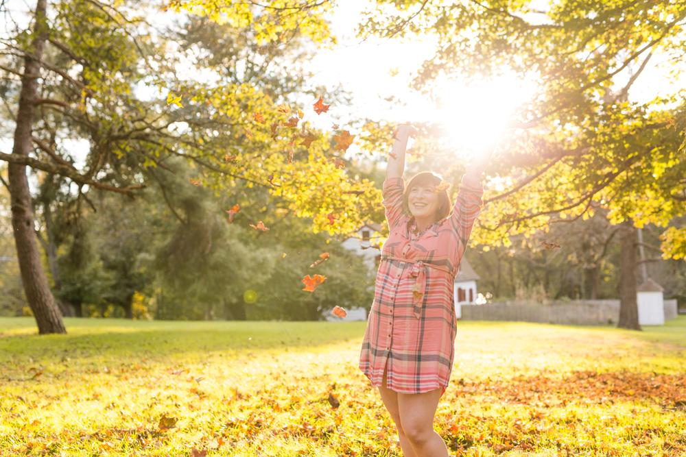 throwing leaves in air pose